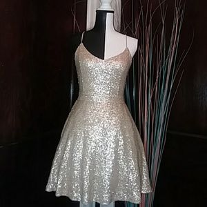 Very pretty sequin nude colored open back dress
